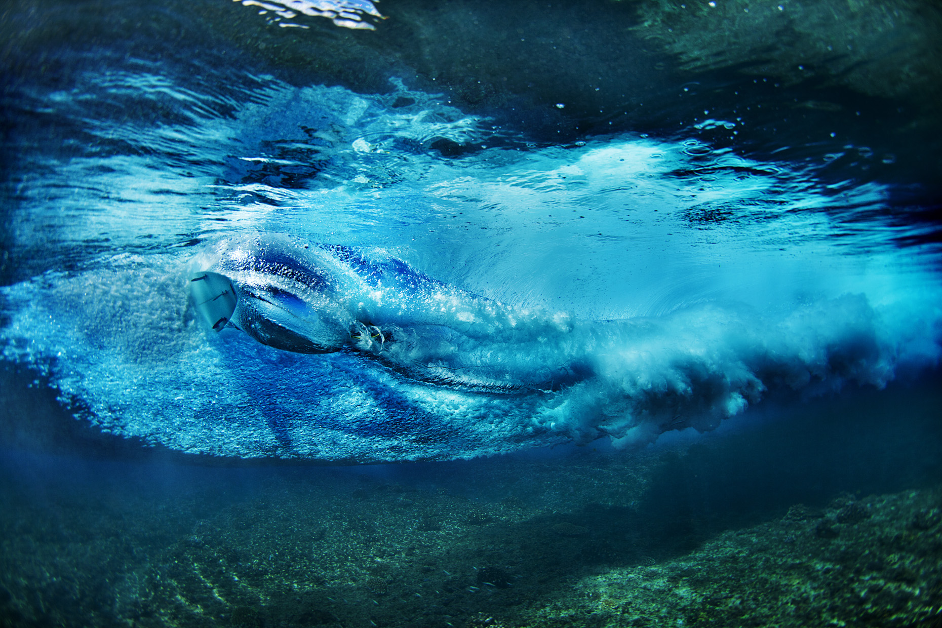 Underwater surfer in Indonesia by Boston based commercial sports photographer Brian Nevins