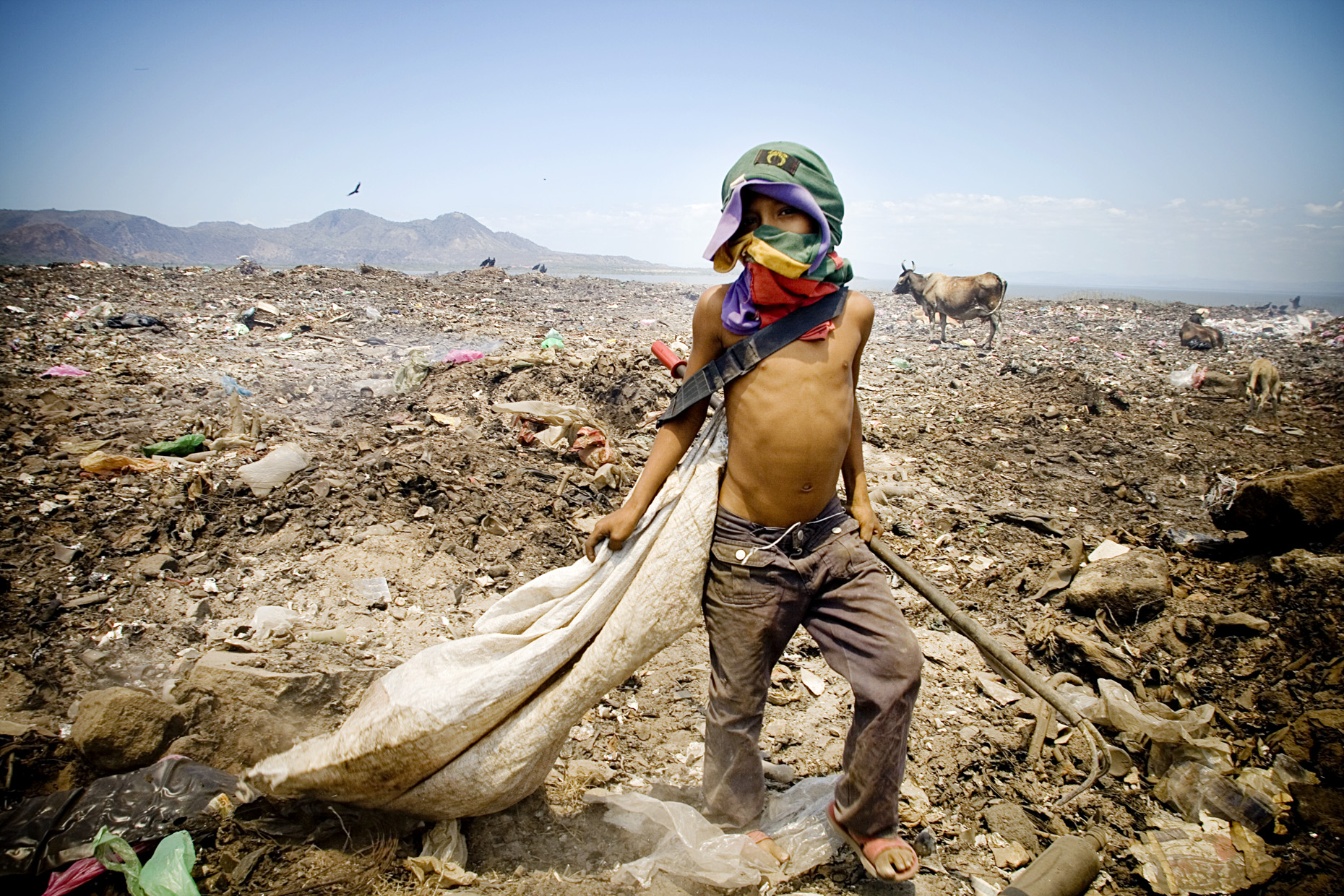 Child Worker in La Chureca  by Boston based commercial lifestyle photographer Brian Nevins